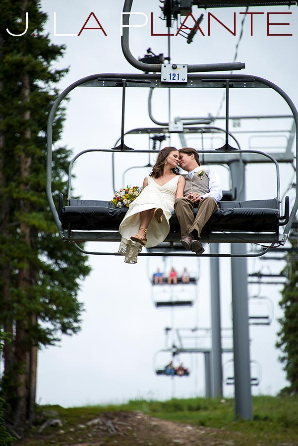 J. La Plante Photo | Colorado Rocky Mountain Wedding Photography | Copper Mountain Wedding | Bride and groom on chairlift