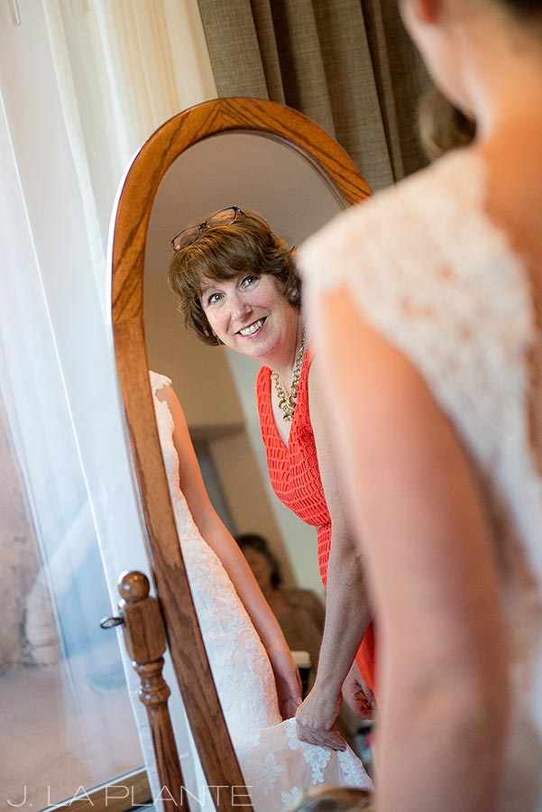 J. La Plante Photo | Denver Wedding Photographer | Golden Colorado Wedding | Mother Helping Bride Into Dress