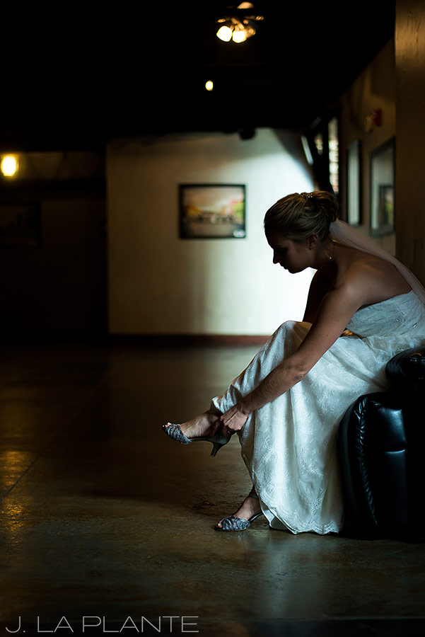 J. La Plante Photo | Denver Wedding Photographer | Mile High Station Wedding | Bride Putting on Shoes