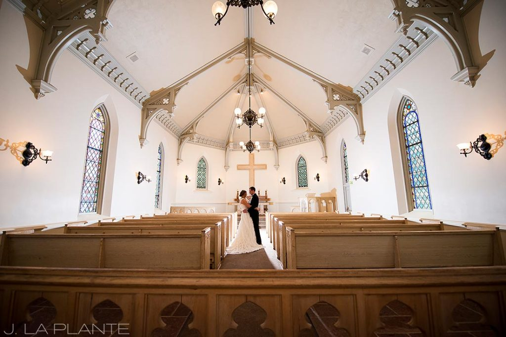J. La Plante Photo | Denver Wedding Photographer | University of Denver Wedding | Evans Chapel Wedding | Bride and Groom Alone in Chapel