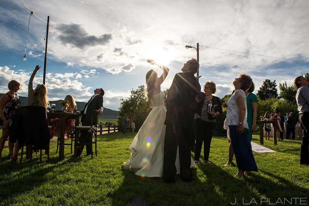 J. La Plante Photo | Denver Wedding Photographer | Chatfield Botanic Gardens Wedding | Bride Waving to Helicopter