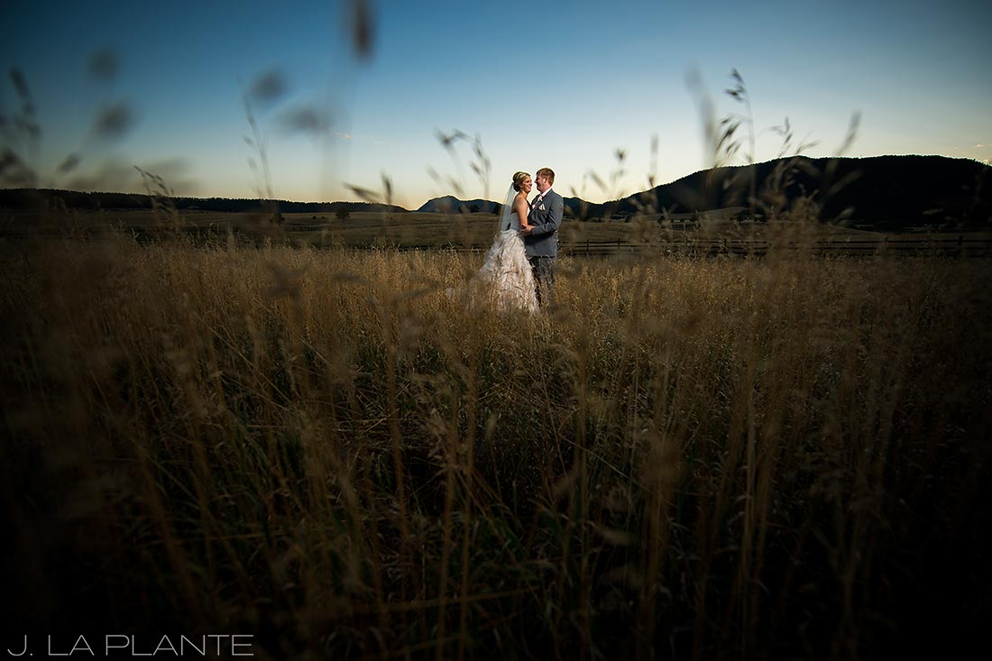 J. LaPlante Photo | Colorado Wedding Photographer | Spruce Mountain Ranch Wedding | Bride and Groom in Field