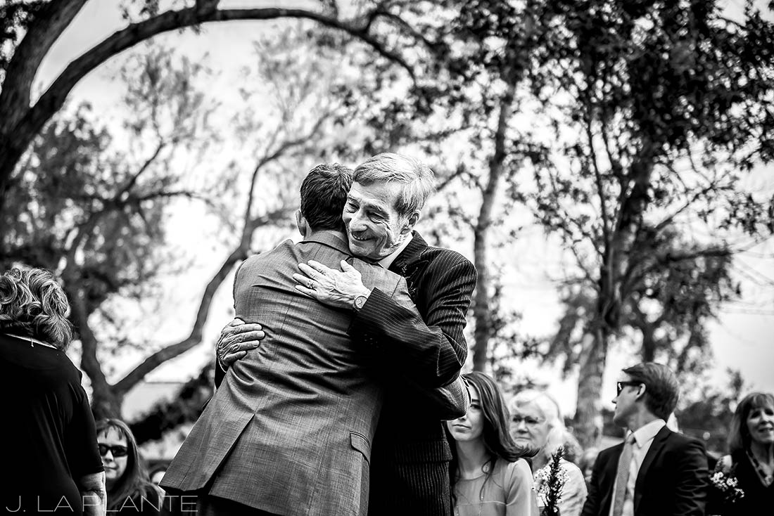 J. La Plante Photo | Boulder Wedding Photographer | Planet Bluegrass Wedding | Father Hugging Groom
