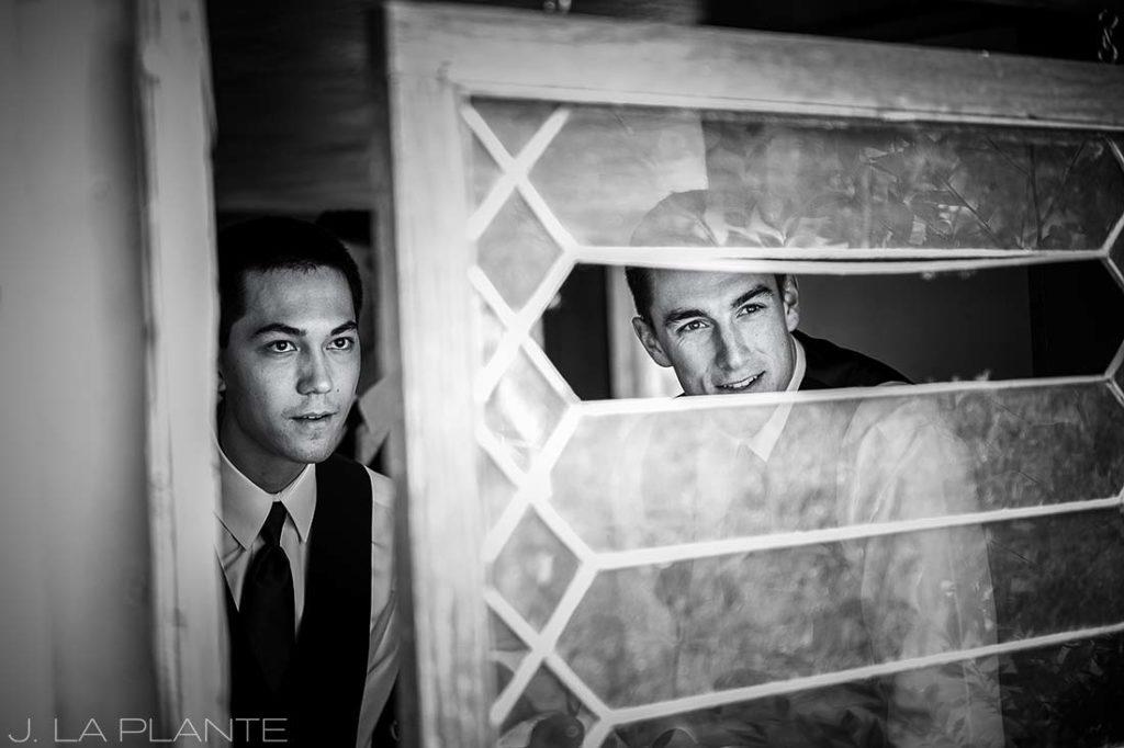 J. LaPlante Photo | Boulder Wedding Photographers | River Bend Wedding | Groomsmen Looking Out Window