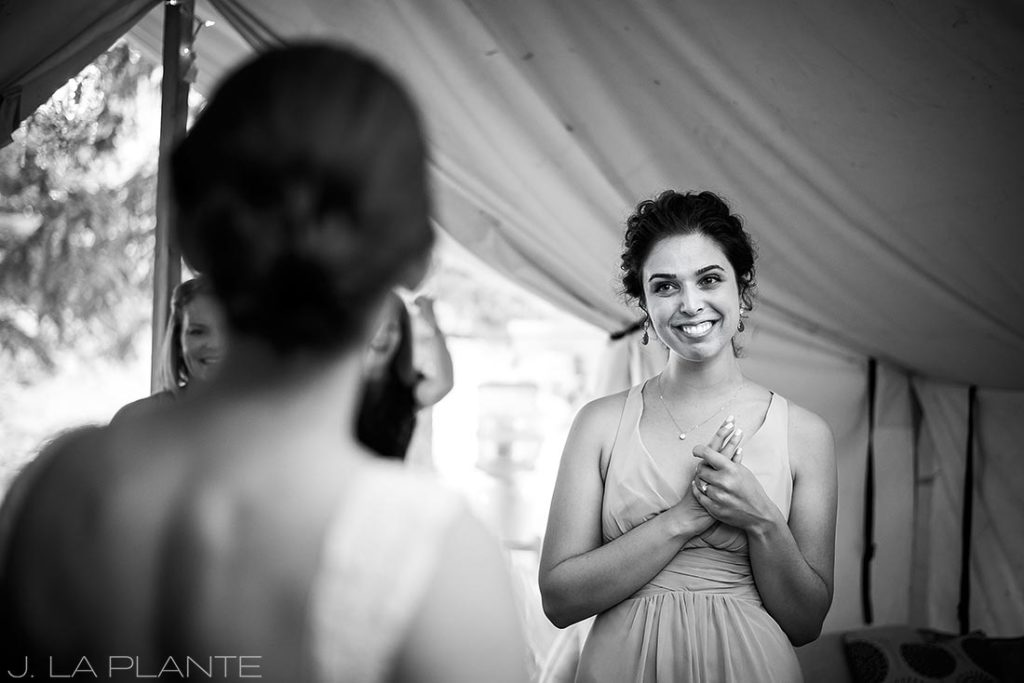 J. LaPlante Photo | Boulder Wedding Photographers | River Bend Wedding | Bride and Maid of Honor Moment