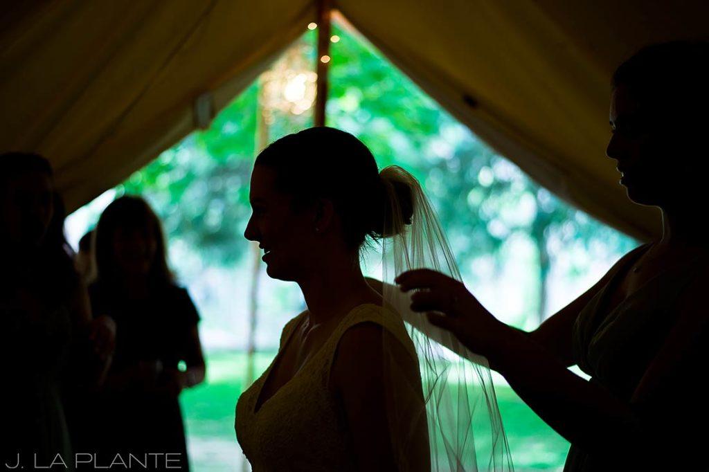 J. LaPlante Photo | Boulder Wedding Photographers | River Bend Wedding | Maid of Honor Putting Veil on Bride