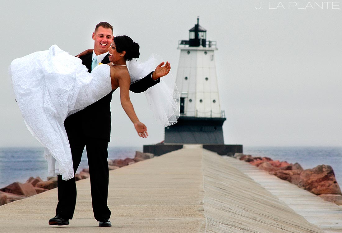 J. LaPlante Photo | Ludington Wedding Photographer | Ludington Michigan Beach Wedding | Bride and Groom with Lighthouse