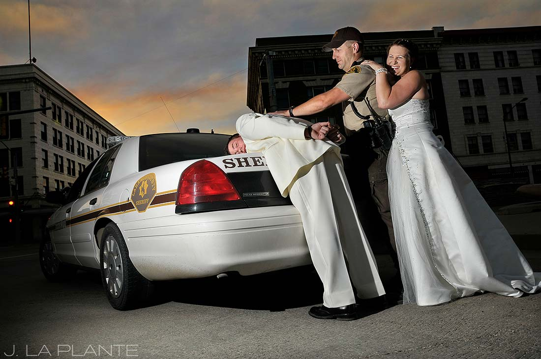 J. LaPlante Photo | Cheyenne Wedding Photographer | Downtown Cheyenne Wedding | Groom Getting Arrested