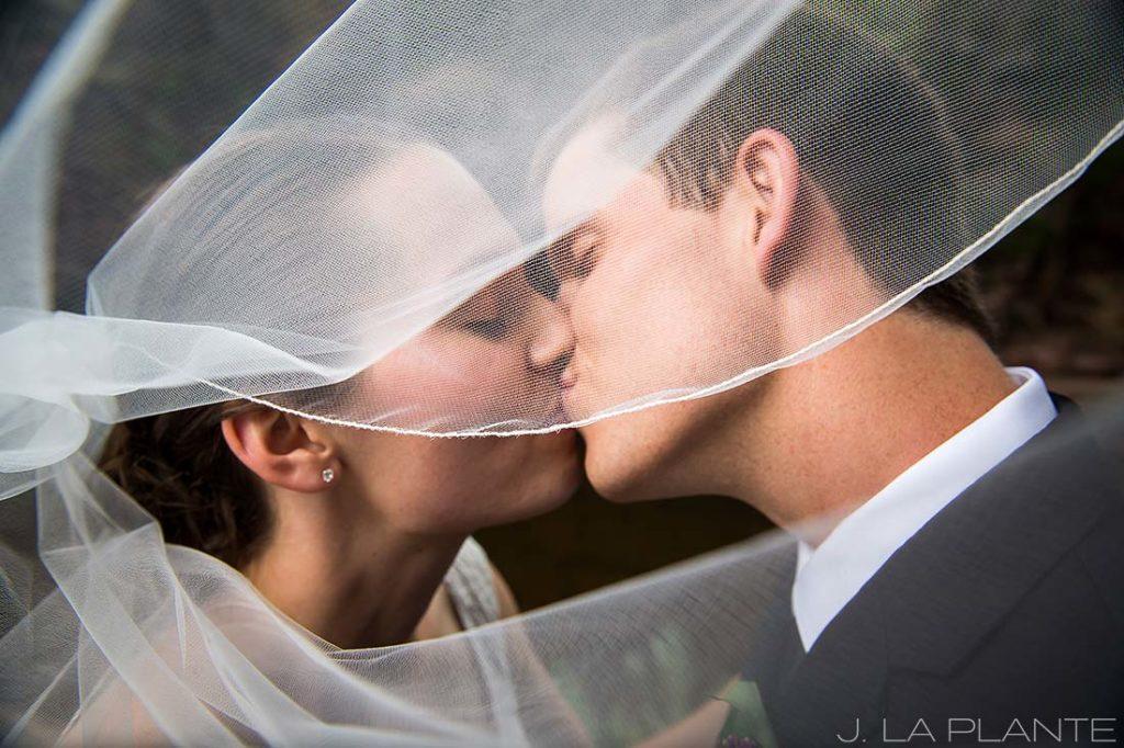 J. LaPlante Photo | Boulder Wedding Photographers | River Bend Wedding | Bride and Groom in Veil