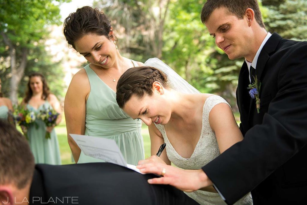 J. LaPlante Photo | Colorado Wedding Photographers | River Bend Wedding | Bride Signing Marriage License