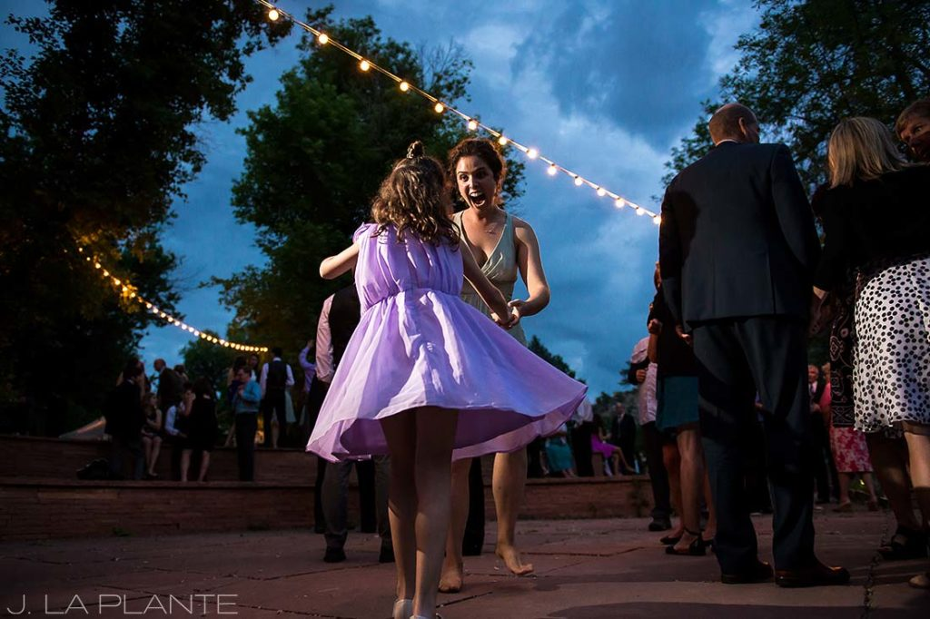 J. LaPlante Photo | Colorado Wedding Photographers | River Bend Wedding | Maid of Honor and Flower Girl Dancing