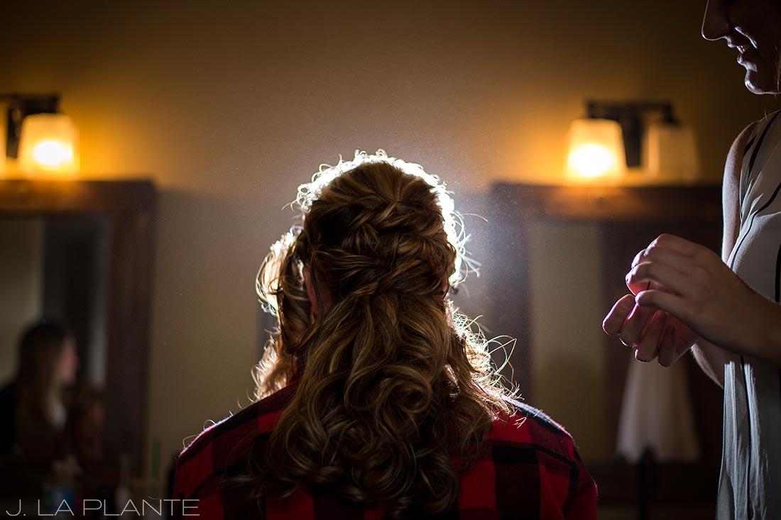 J. La Plante Photo | Winter Park Colorado Wedding Photographer | Devil's Thumb Ranch Wedding | Bride Getting Hair Done
