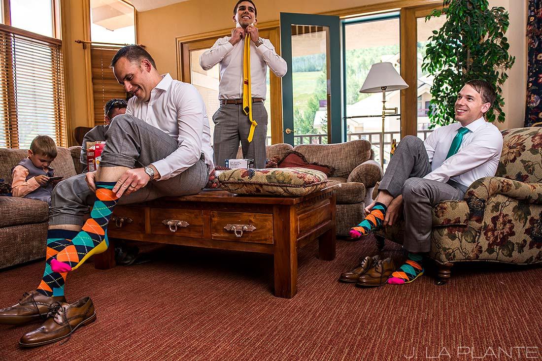 J. La Plante Photo   Beaver Creek Wedding Photographers   Beaver Creek Lodge Wedding   Groom Putting on Funny Socks