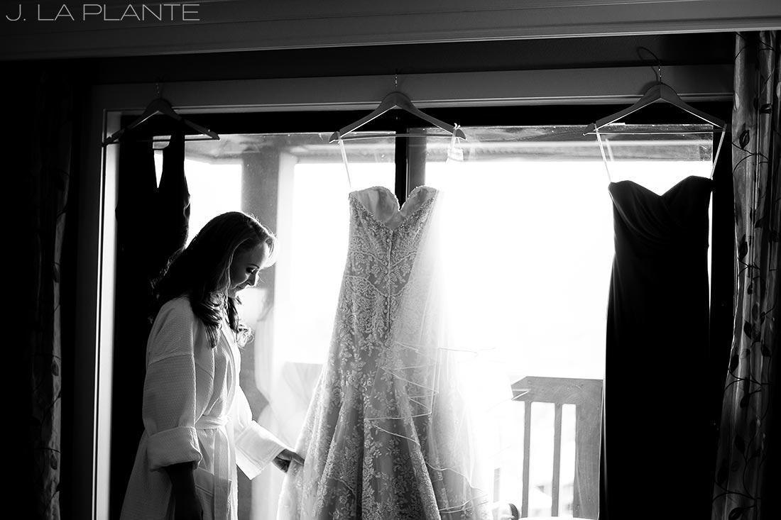 J. LaPlante Photo | Colorado Springs Wedding Photographers | Cheyenne Mountain Resort Wedding | Bride Touching Wedding Dress