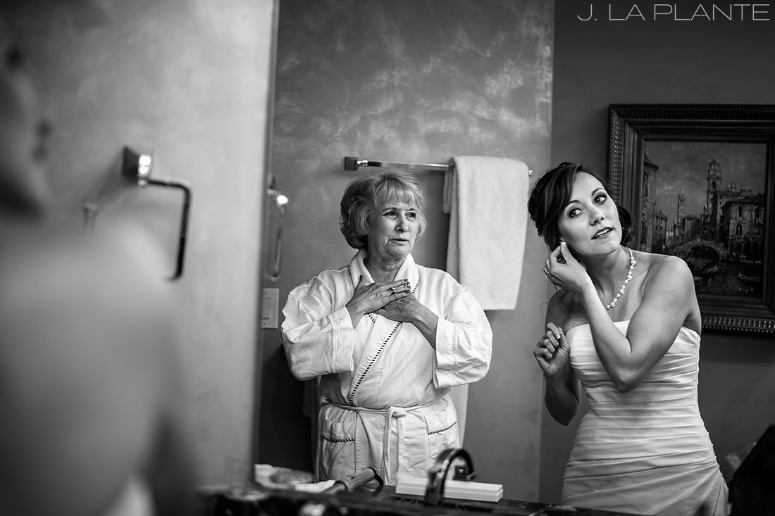 J. La Plante Photo   Beaver Creek Wedding Photographers   Beaver Creek Lodge Wedding   Bride and Groom Putting on Earrings