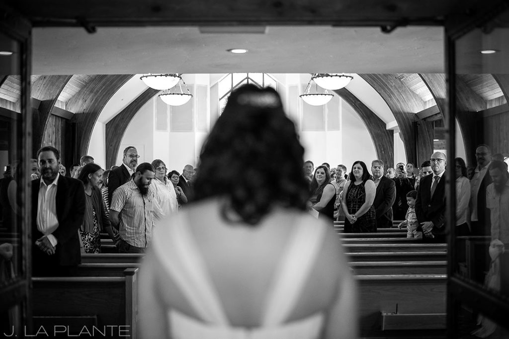 J. La Plante Photo   Vail Wedding Photographers   Vail Interfaith Chapel Wedding   Bride Walking Down Aisle