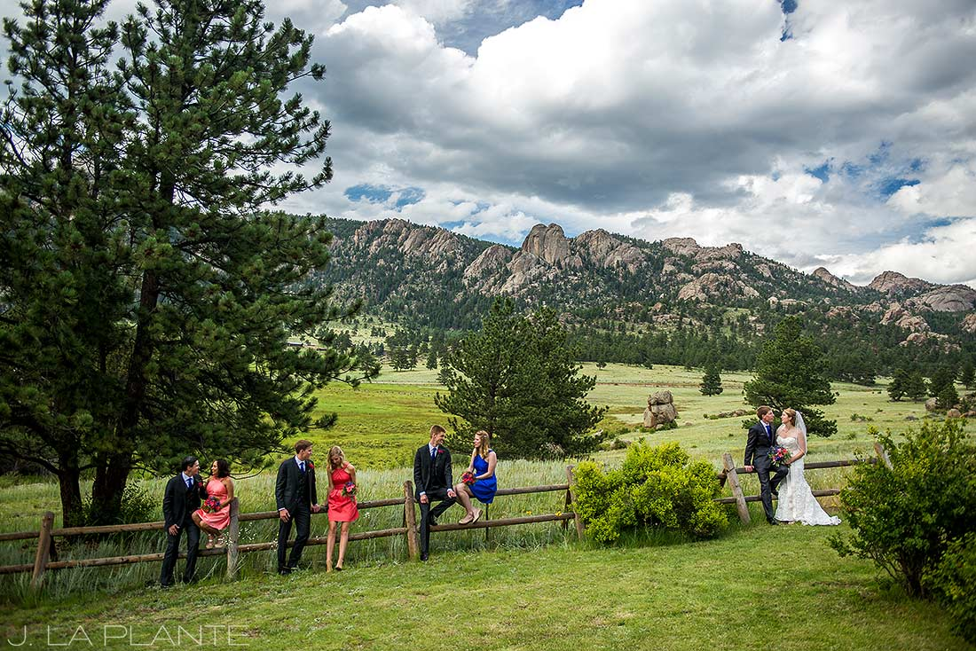 J. La Plante Photo | Estes Park Wedding Photographer | Black Canyon Inn Wedding | Bridal Party Sitting on Fence