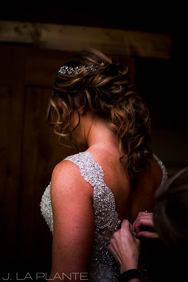 J. La Plante Photo | Winter Park Colorado Wedding Photographer | Devil's Thumb Ranch Wedding | Bride Getting Into Dress