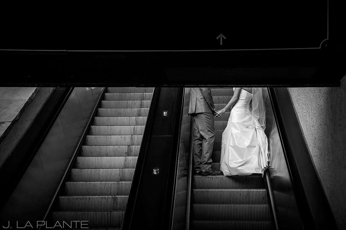 J. La Plante Photo   Beaver Creek Wedding Photographers   Beaver Creek Resort Wedding   Bride and Groom on Escalator