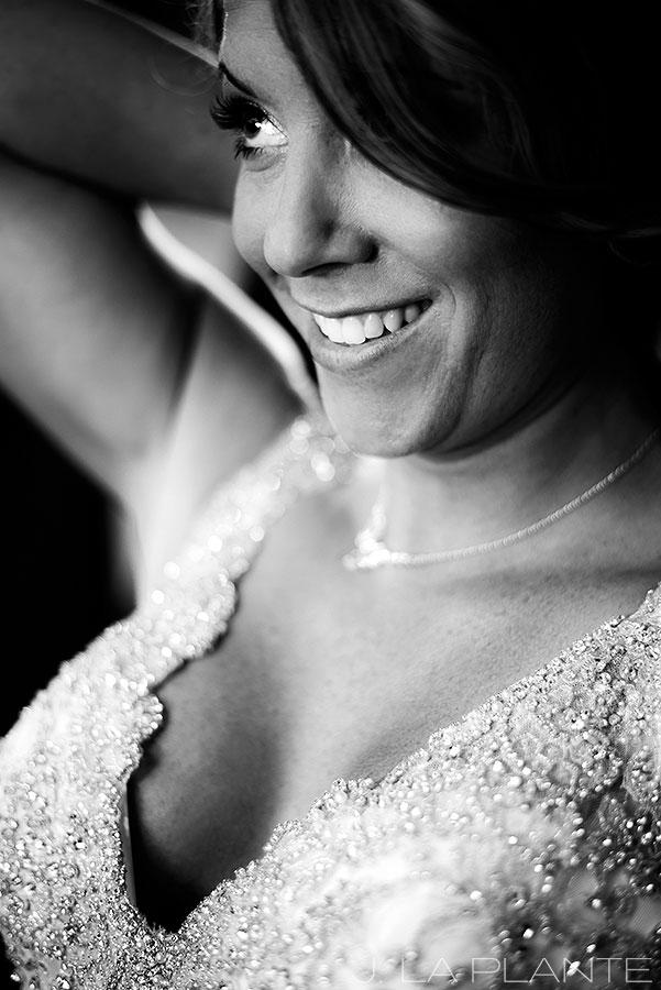 J. La Plante Photo | Winter Park Colorado Wedding Photographer | Devil's Thumb Ranch Wedding | Bride Putting on Necklace