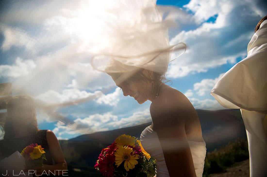 J. La Plante Photo   Beaver Creek Wedding Photographers   Beaver Creek Mountain Wedding   Bride Veil Blowing in Wind