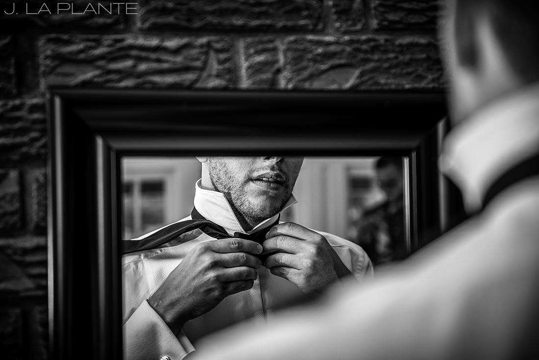 J. La Plante Photo | Boulder Wedding Photographers | Wedgewood on Boulder Creek Wedding | Groom Tying Bow Tie