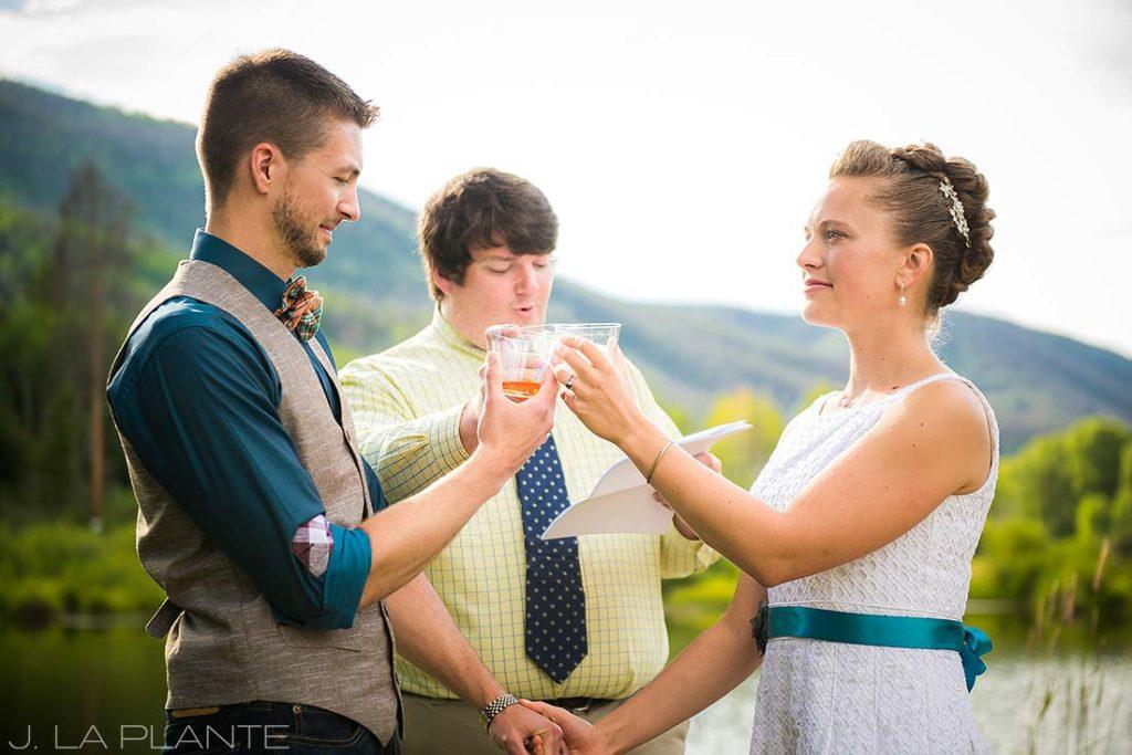 J. La Plante Photo | Rocky Mountain Wedding Photographer | Shadow Mountain Ranch Wedding | Bride and Groom Toasting
