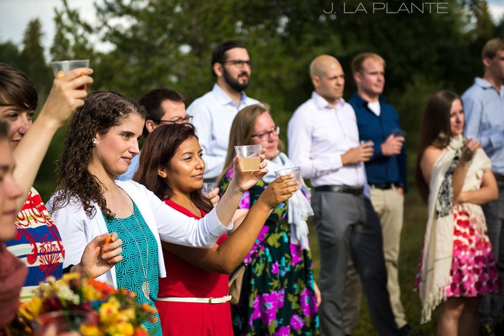 wedding guests doing a toast during ceremony