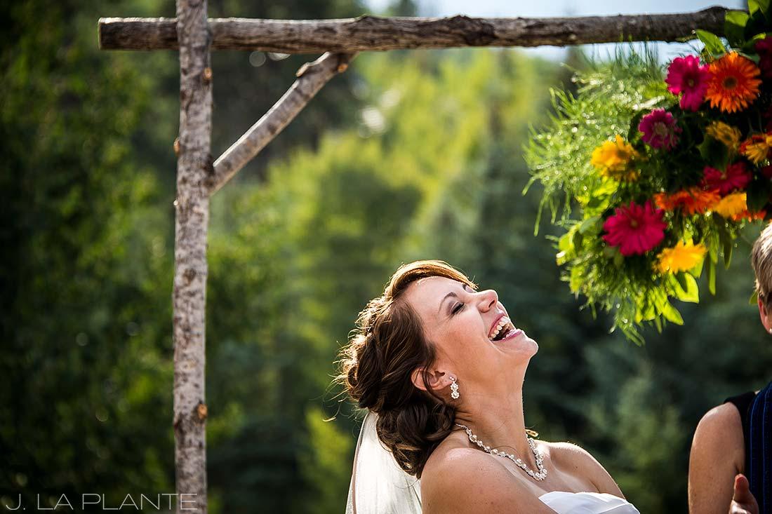 J. La Plante Photo   Beaver Creek Wedding Photographers   Beaver Creek Lodge Wedding   Bride Laughing During Ceremony