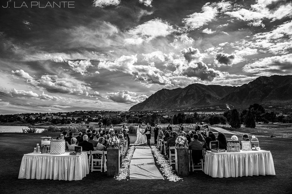 black and white photo of ceremony at golf course