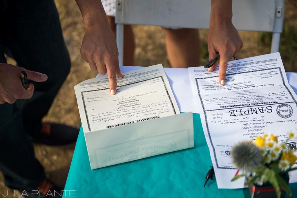 J. La Plante Photo | Rocky Mountain Wedding Photographer | Granby Colorado Wedding | Signing the Marriage License