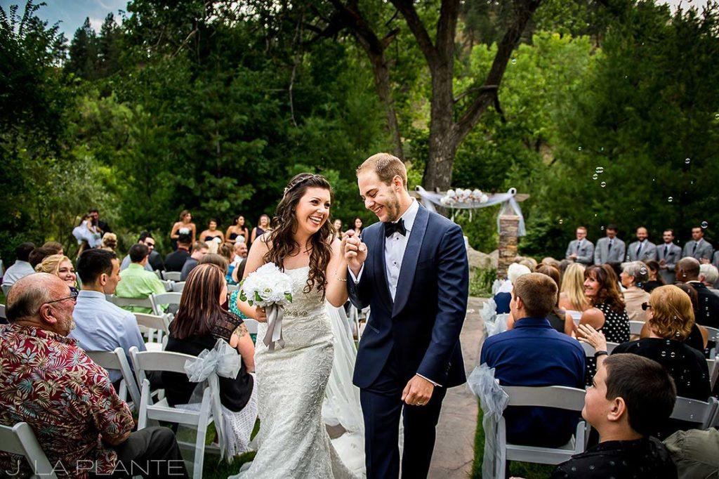 J. La Plante Photo | Boulder Wedding Photographers | Wedgewood on Boulder Creek Wedding | Bride and Groom Exiting Ceremony