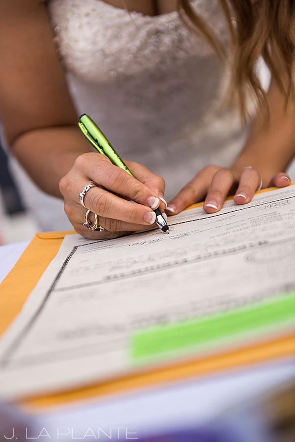 J. LaPlante Photo | Boulder Wedding Photographer | Mon Cheri Wedding | Bride Signing Marriage License