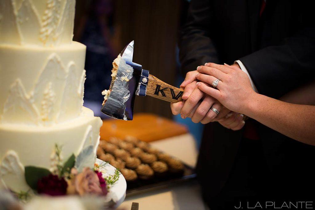 J. La Plante Photo | Winter Park Colorado Wedding Photographer | Devil's Thumb Ranch Wedding | Cutting the Cake with a Fireman Axe