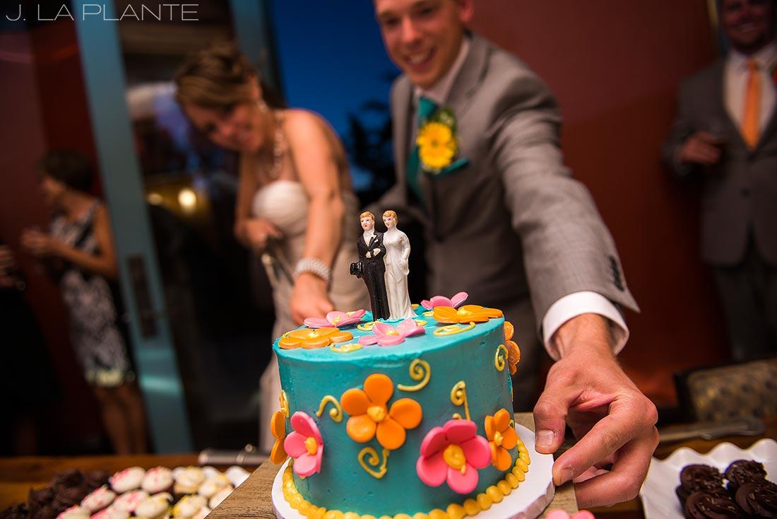J. La Plante Photo   Beaver Creek Wedding Photographers   Beaver Creek Lodge Wedding   Cutting the Cake with a Sword