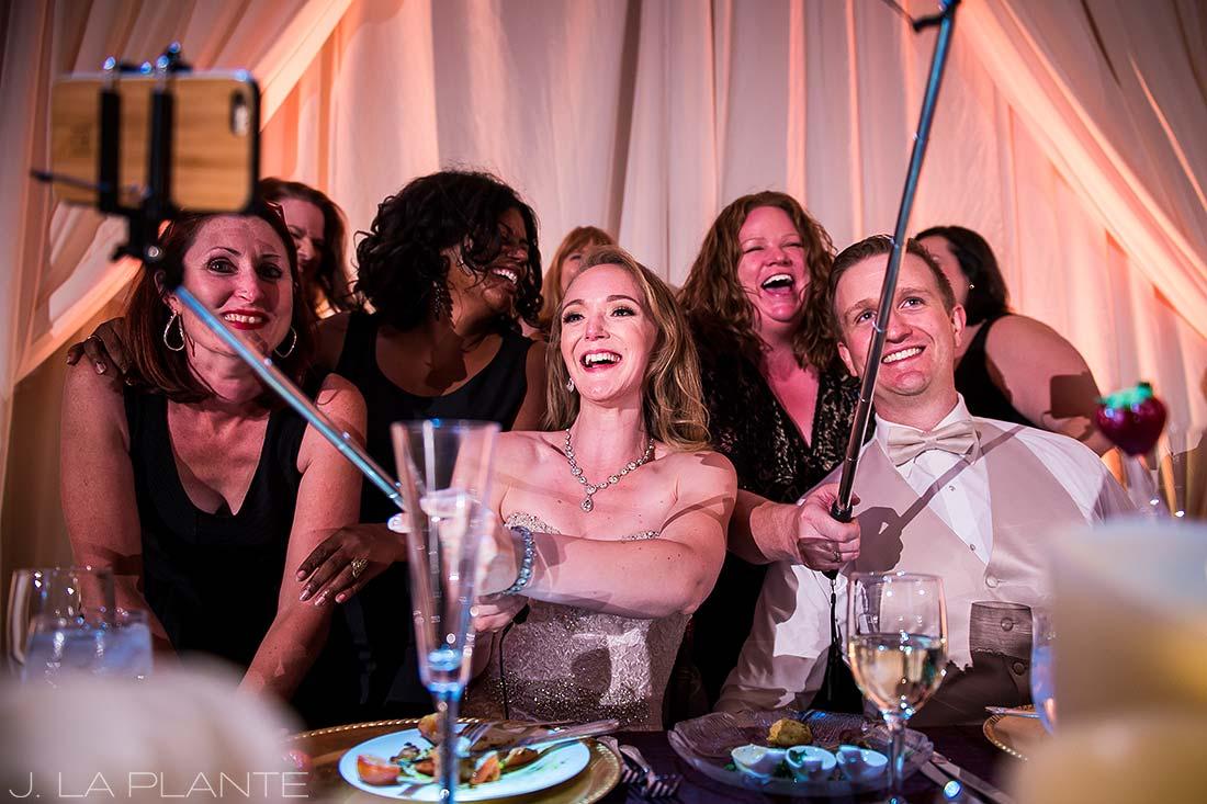 J. LaPlante Photo | Colorado Springs Wedding Photographers | Cheyenne Mountain Resort Wedding | Bride and Groom Taking Selfies with Guests