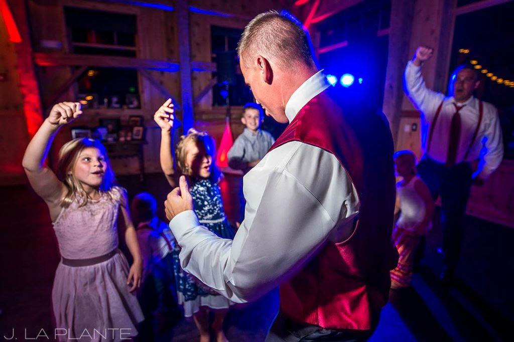 J. La Plante Photo | Winter Park Colorado Wedding Photographer | Devil's Thumb Ranch Wedding | Groom Dancing with Flower Girls