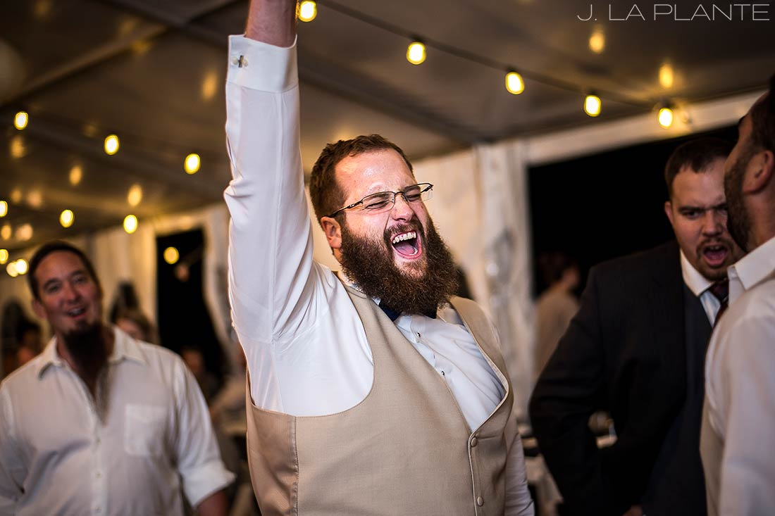 J. LaPlante Photo | Colorado Wedding Photographer | Mon Cheri Wedding | Groomsman Rocking Out