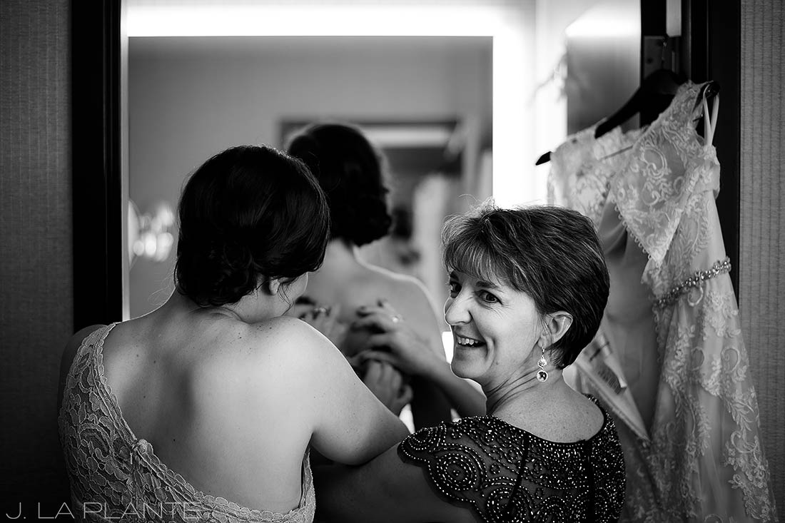 J. La Plante Photo | Denver Wedding Photographer | Grand Hyatt Wedding | Bridesmaids getting into dresses