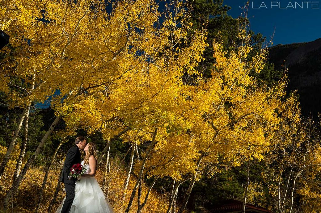 Bride and groom in aspen | Fall wedding at Della Terra | Estes Park wedding photographers | J. La Plante Photo
