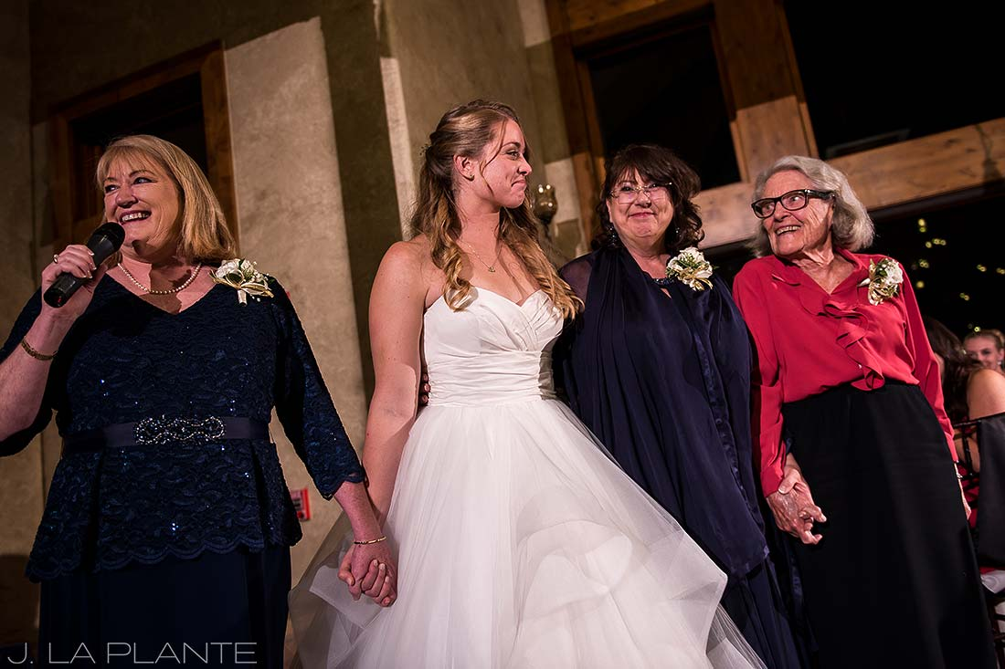 Bride holding hands with mother | Fall wedding at Della Terra | Estes Park wedding photographers | J. La Plante Photo