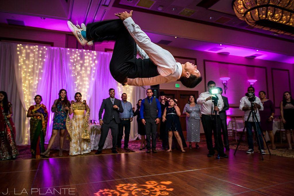 wedding dj doing a flip on the dancefloor