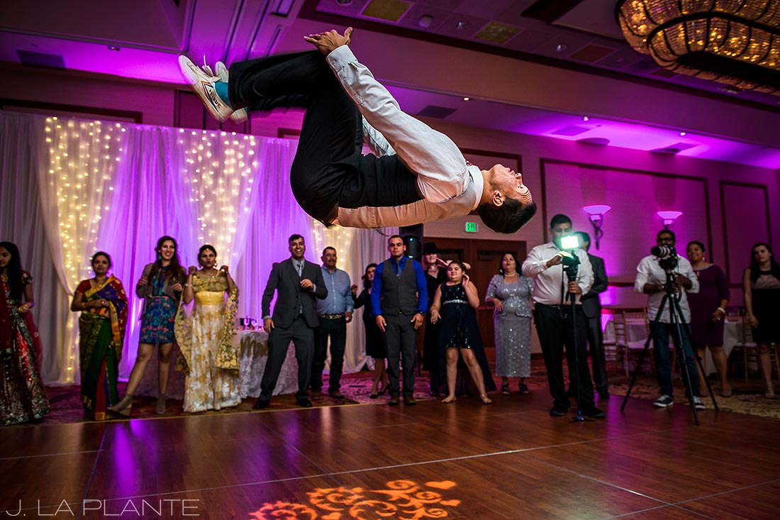 Dancer flipping in air | Hindu wedding in Colorado Springs | Cheyenne Mountain Resort wedding | J. La Plante Photo