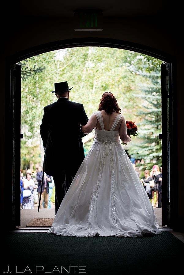 J. LaPlante Photo   Vail Wedding Photographers   Vail Interfaith Chapel Wedding   Bride and Groom Leaving Church