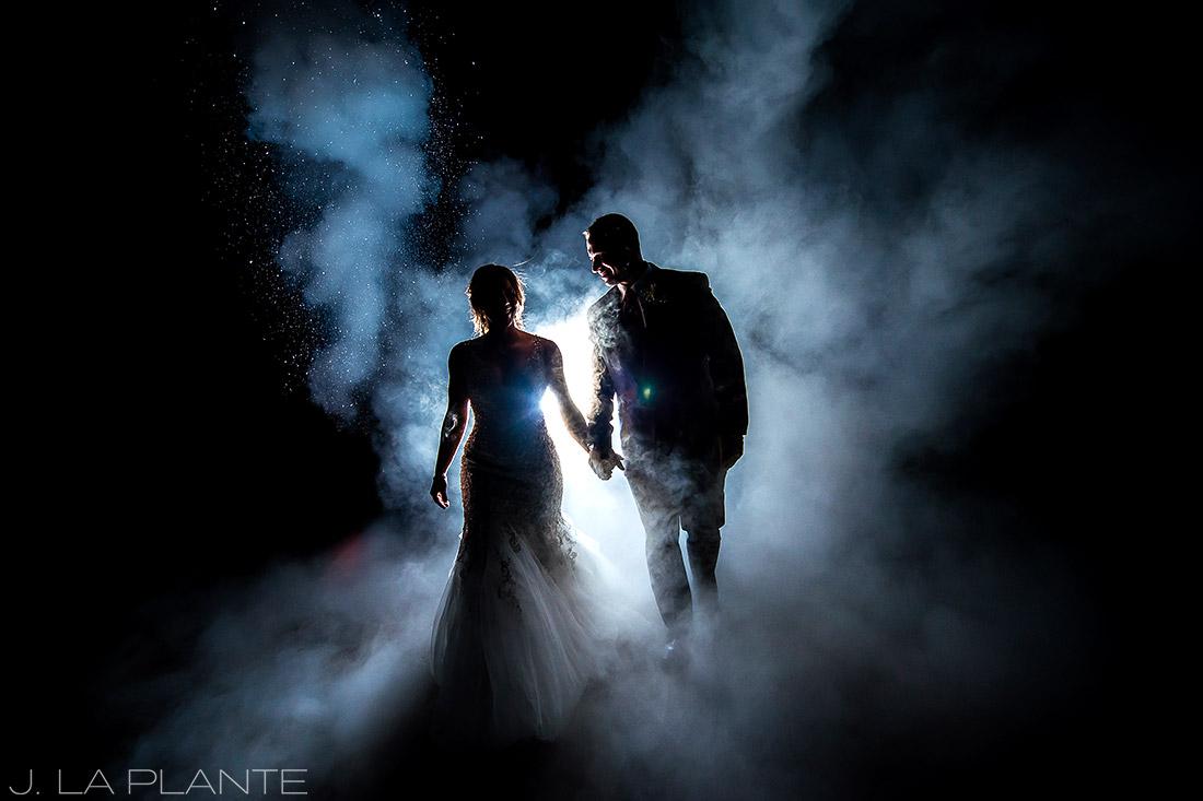 J. LaPlante Photo   Colorado Wedding Photographers   Devil's Thumb Ranch Wedding   Bride and Groom Fire Extinguisher Portrait