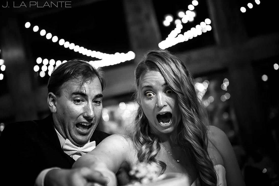 J. LaPlante Photo   Estes Park Wedding Photographers   Della Terra Wedding   Bride and Groom Cutting Cake