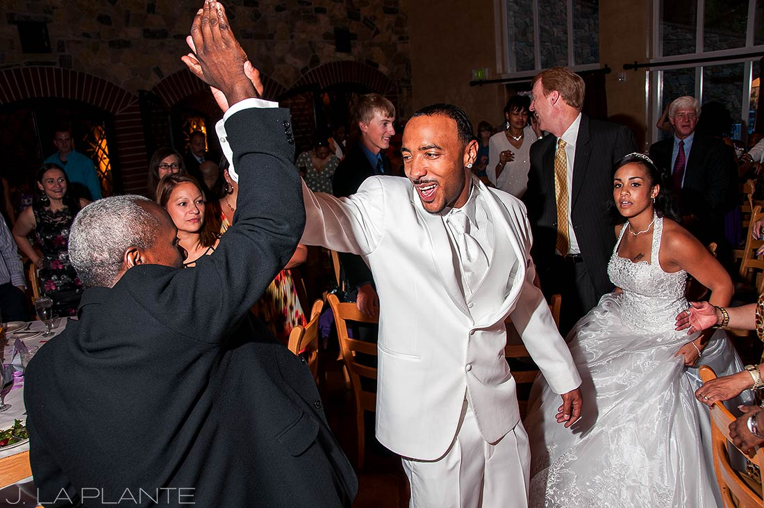 J. La Plante Photo | Denver Wedding Photographer | University of Denver Wedding | Groom High Fiving During Entrance