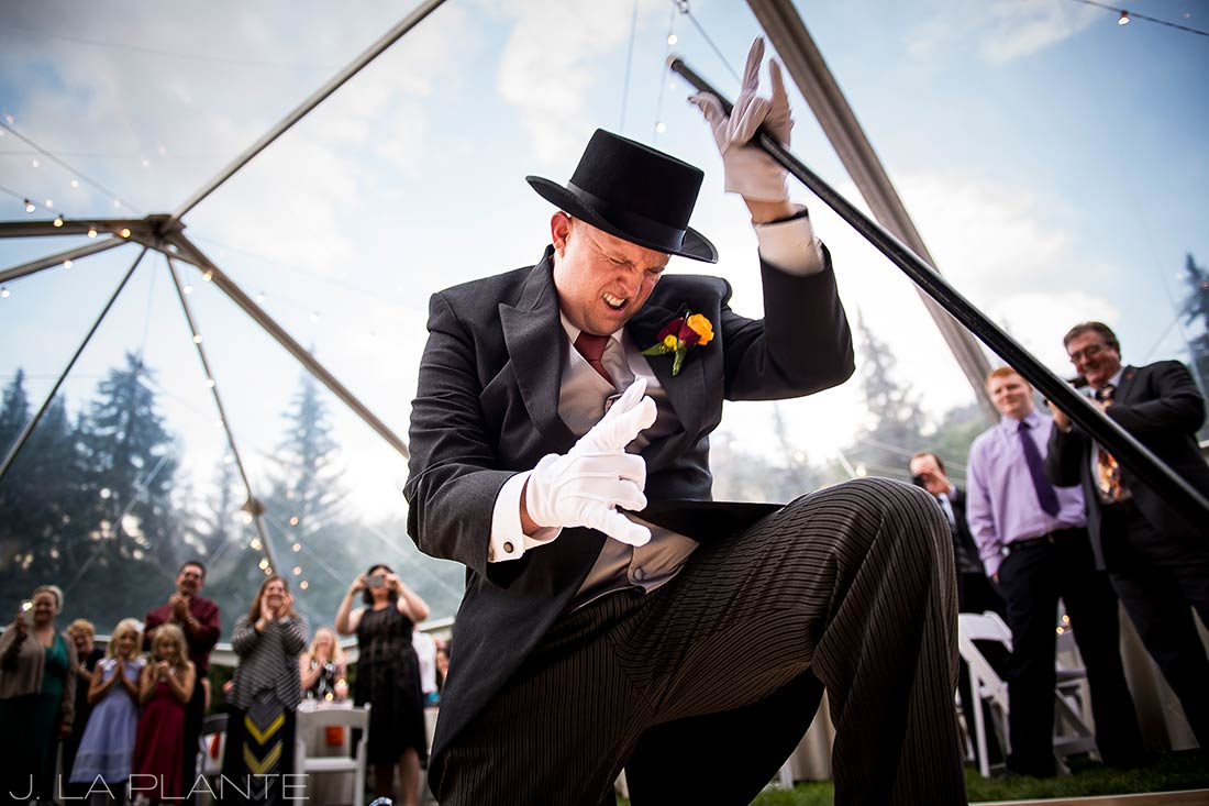 J. La Plante Photo | Vail Wedding Photographer | Lion Square Lodge Wedding | Groom Rocking Out During Entrance