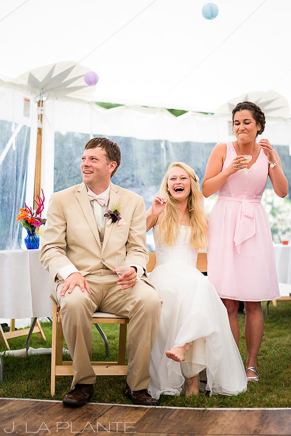 J. La Plante Photo | Maine Wedding Photographer | River Lily Farm Wedding | Bride and Groom Laughing at Speech