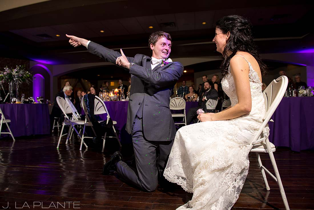 J. LaPlante Photo | Colorado Wedding Photographers | Pines at Genesee Wedding | Funny Garter Toss Photo